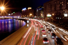 The image of night traffic jam on city embankment in Moscow